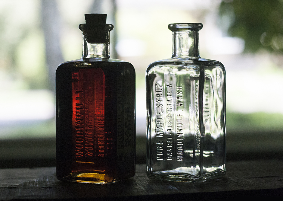 A custom glass bottle for woodinville whiskey barrel aged for Unique glass bottles