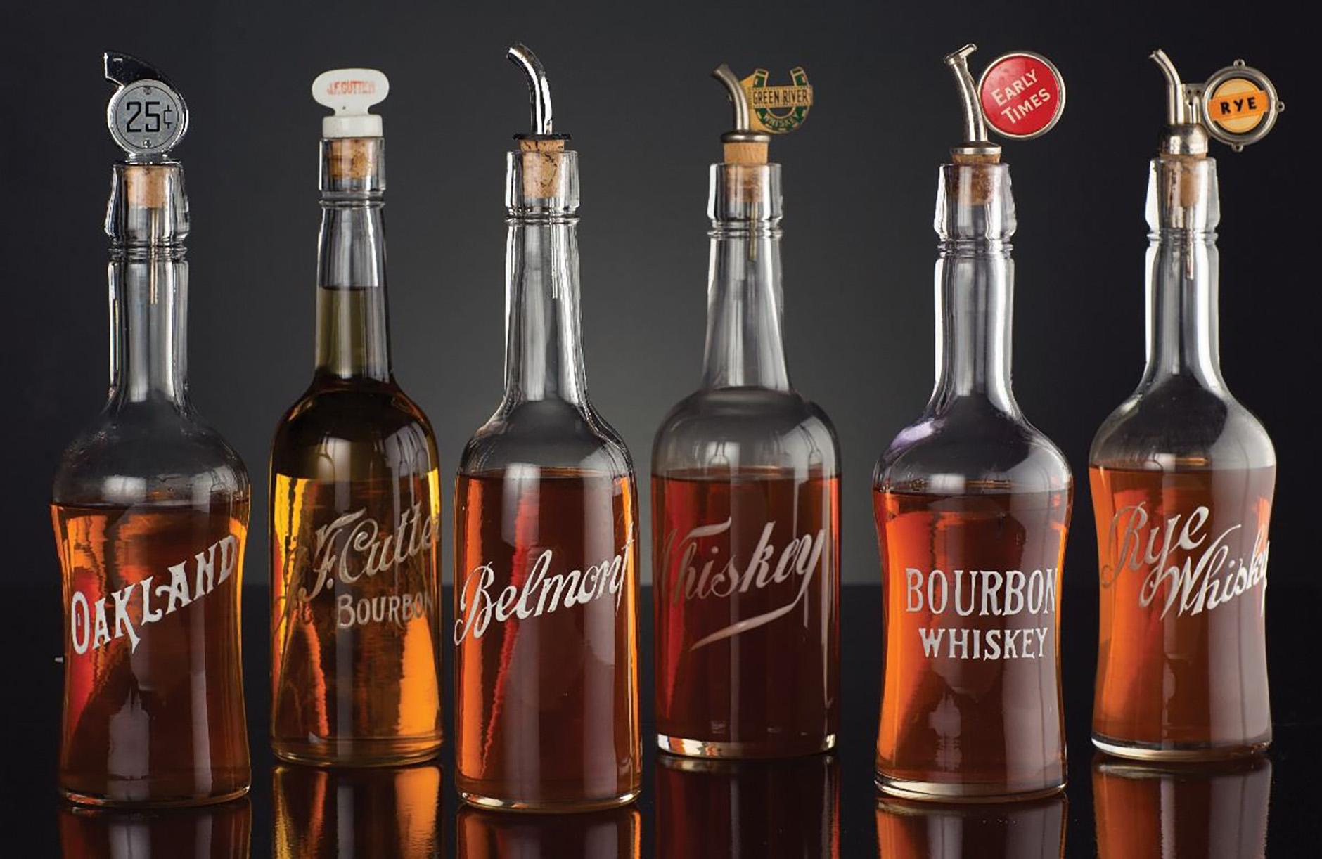 antique enamel back bar whiskey bottles